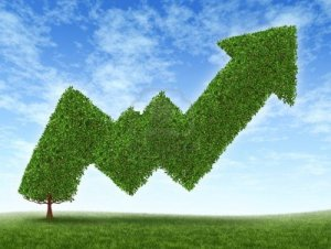 12353889-stock-market-growth-and-success-with-a-growing-green-tree-in-the-shape-of-a-stock-investment-graph-s